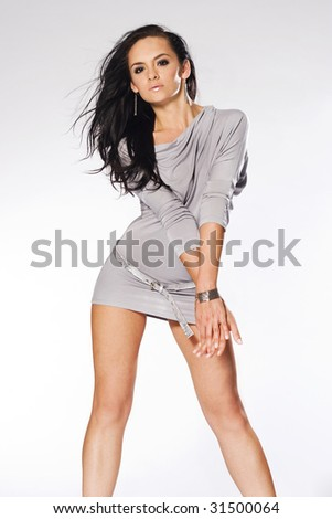 beautiful and sexy brunette girl on white background - stock photo