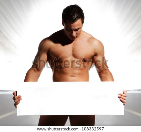 beautiful and sexy naked and well trained sports man is holding and displaying a white board in his hands on were you can write text - stock photo