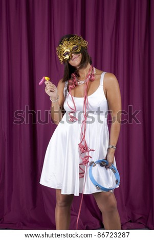 beautiful and sexy woman celebrating with a seductive mask - stock photo