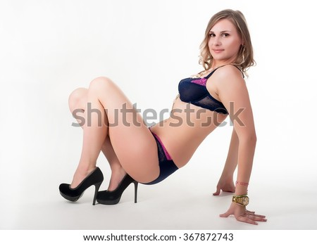 Beautiful and sexy woman in lingerie over white background - stock photo