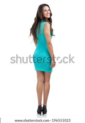 Beautiful and sexy woman looking back and smiling, isolated on white - stock photo