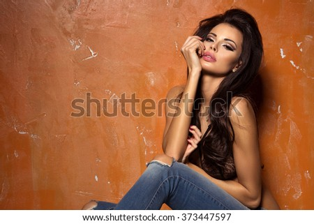 Beautiful and sexy woman wearing lingerie and jeans  - stock photo