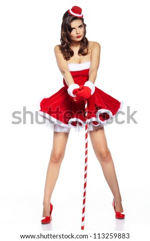 Beautiful and sexy woman wearing santa clause costume - stock photo