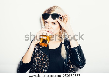 Beautiful and sexy young blond woman drinking beer, not isolated on white background - stock photo