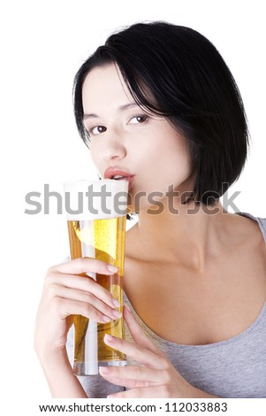 Beautiful and sexy young woman drinking beer, isolated on white - stock photo