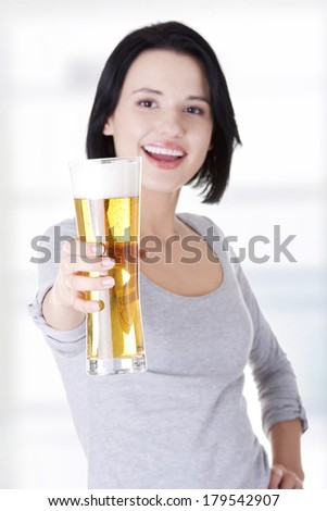 Beautiful and sexy young woman with beer - stock photo