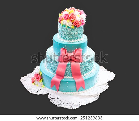 Beautiful and tall wedding cake on a dark background - stock photo