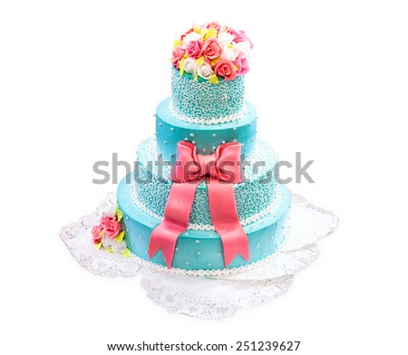 Beautiful and tall wedding cake on a white background - stock photo
