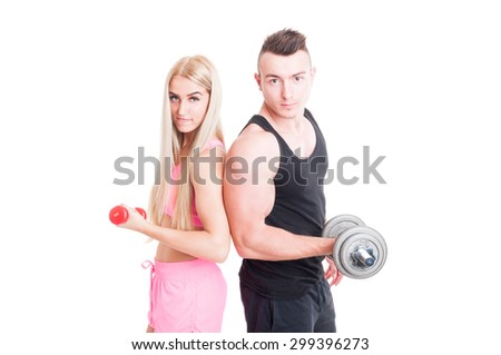 Beautiful and young fitness couple holding weights isolated on white - stock photo