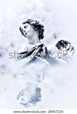 beautiful angel with white lilies in reflecting background - stock photo