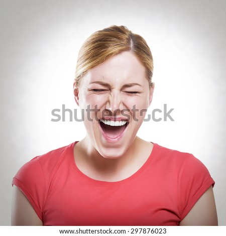 Beautiful angry blonde woman cry. Toned photo. - stock photo