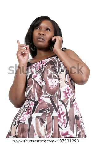 Beautiful angry woman talking on a cell phone - stock photo