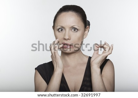 beautiful anguish expressing woman portrait on isolated background - stock photo