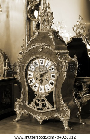 beautiful antique clock on the background of the mirror - stock photo