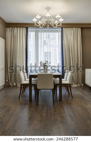 beautiful apartment, interior room with table and five chairs - stock photo