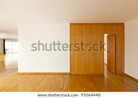 beautiful apartment, interior with hardwood floors, closet - stock photo