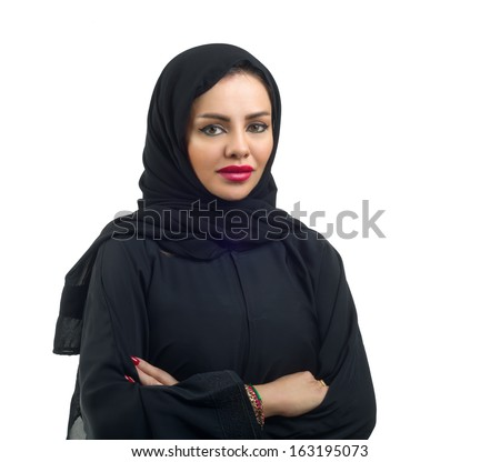 Beautiful Arabian model in hijab posing and isolated on white - stock photo