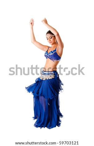 Beautiful Arabic belly dancer harem woman in blue with silver dress and head jewelry with gem dancing swirling skirt, isolated. - stock photo