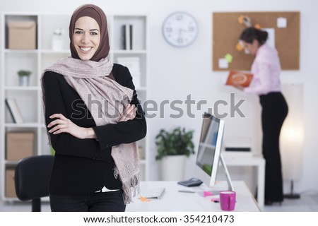 Beautiful Arabic business woman working on computer. Woman in her office Shallow depth of field. - stock photo