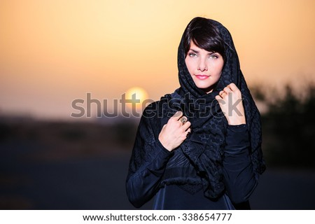Beautiful arabic woman face posing on sunset background. - stock photo