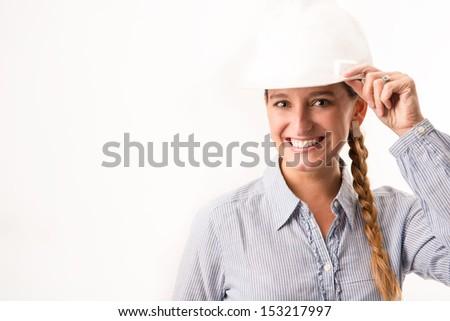 Beautiful architect girl holding her helmet - stock photo