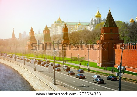 Beautiful architecture of The Kremlin's fortified complex, palace and golden onion-domed cathedrals, with the Moskva River on the left. - stock photo