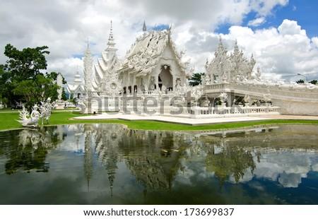 Beautiful art of white temple in Thailand ,Wat Rong Khun, Chiang Rai. - stock photo