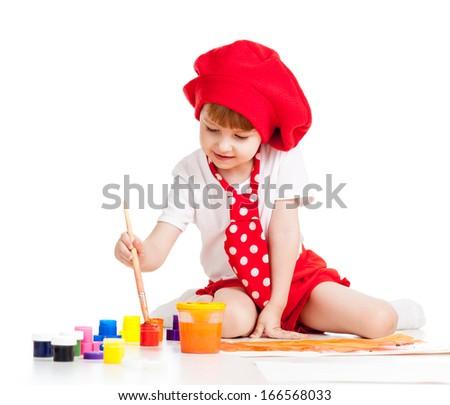 beautiful artist child painting with brush - stock photo