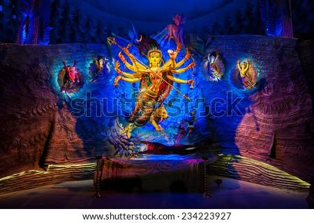 Beautiful artistic idol of Goddess Durga with dramatic lighting being worshipped during Dussera festival. - stock photo