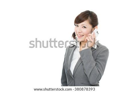 Beautiful asian business woman using a cellular phone - stock photo