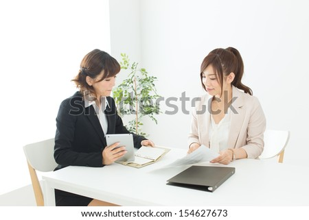 Beautiful asian business women in the office - stock photo
