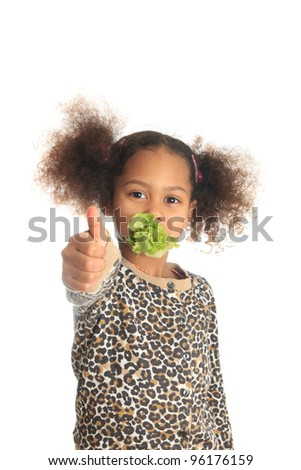 beautiful asian child African American Black child eats salad isolated metisse - stock photo