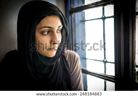 Beautiful asian girl by the window - stock photo