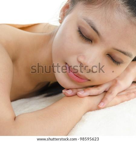 Beautiful Asian Girl having a back massage - stock photo