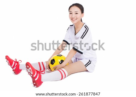 beautiful asian girl holding a soccer ball, white background - stock photo