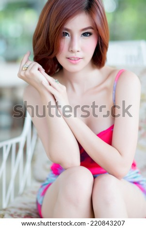 Beautiful asian girl in park - stock photo