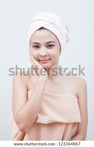beautiful asian girl in spa in isolated - stock photo