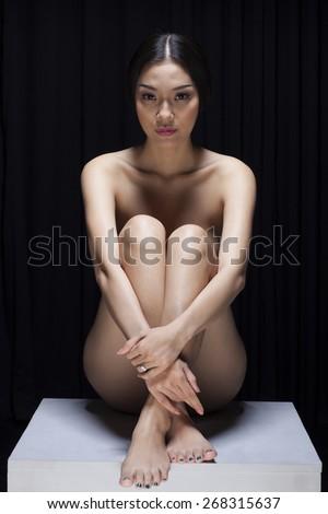 Beautiful Asian girl practicing yoga nude - stock photo