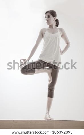 beautiful asian girl with yoga pose - stock photo