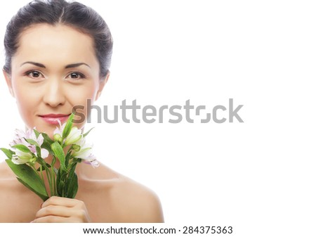 Beautiful asian happy woman with pink flowers, isolated on white - stock photo