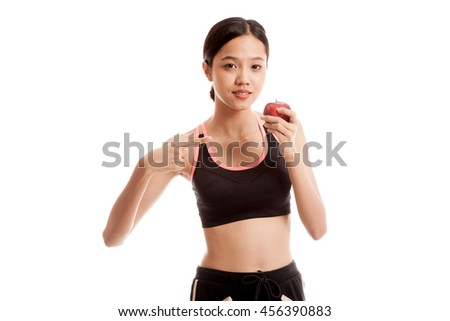 Beautiful Asian healthy girl point to red apple  isolated on white background - stock photo