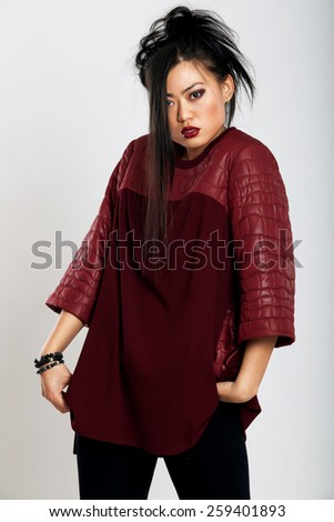 Beautiful Asian in a bright sweater - stock photo