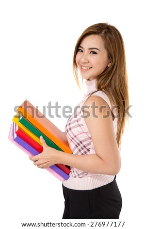 Beautiful Asian student girl holding books on white background - stock photo