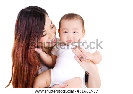 Beautiful asian woman carried her six month old baby boy - stock photo