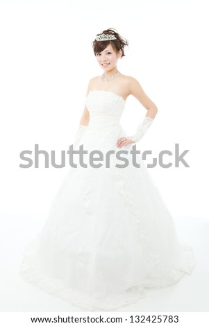 Beautiful asian woman dressed as a bride on white background - stock photo