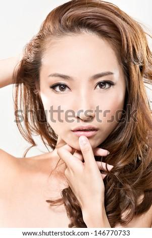 Beautiful Asian woman face, closeup portrait. - stock photo