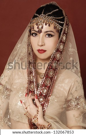 Beautiful asian woman in traditional clothing with bridal makeup and jewelry. - stock photo