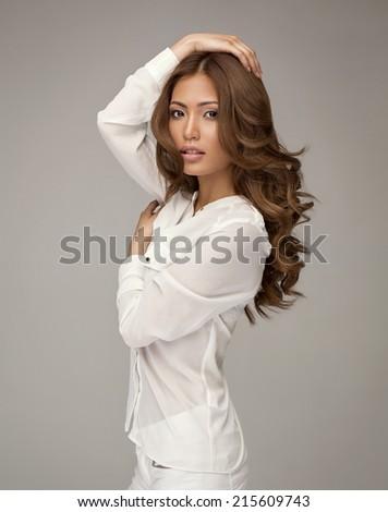 Beautiful asian woman posing - stock photo