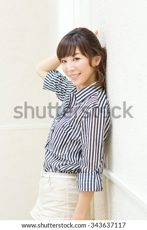 Beautiful asian woman relaxing in the room - stock photo