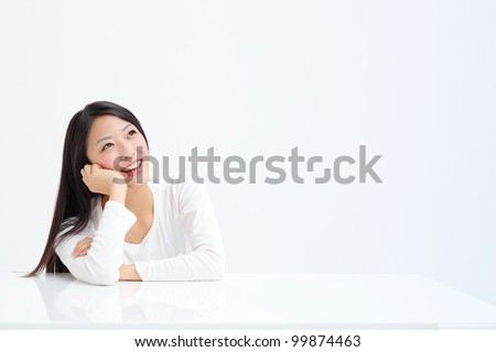 beautiful asian woman thinking - stock photo